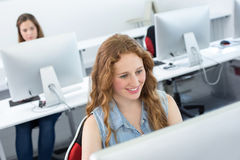 Smiling female student in computer class Royalty Free Stock Image