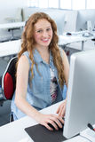 Smiling female student in computer class Stock Images