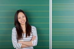 Smiling female student with crossed arms Stock Photos