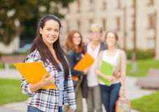 Smiling female student with folders Stock Photo