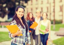 Smiling female student with folders Stock Images