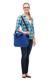 Smiling female student in glasses with laptop bag Stock Photography
