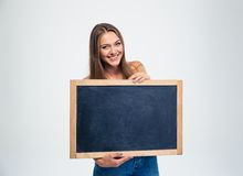 Smiling female student holding blank board Stock Photos