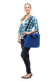 Smiling female student with laptop bag Stock Photo