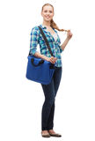Smiling female student with laptop bag Royalty Free Stock Images
