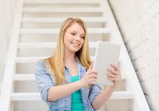 Smiling female student with tablet pc computer Stock Photo
