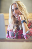 Smiling female student using laptop Royalty Free Stock Images