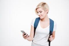 Smiling female student using smartphone Royalty Free Stock Image