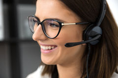 Smiling female support operator in headset Stock Photos
