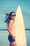Smiling female surfer Stock Images