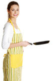 Smiling female teen with a frying pan. stock photography
