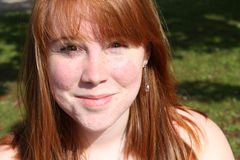 Smiling female teen with red hair Royalty Free Stock Photography