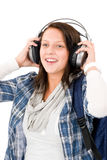 Smiling female teenager enjoy music headphones Royalty Free Stock Images
