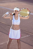 Smiling Female Tennis Athlete Equipped with Professional Outfit Royalty Free Stock Photo