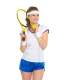 Smiling female tennis player looking on copy space Royalty Free Stock Images