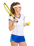Smiling female tennis player with racket and ball Royalty Free Stock Image