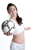 Smiling female to send soccer Royalty Free Stock Images