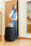 Smiling female tourist  near door in home Stock Photos