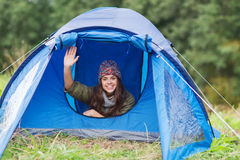 Smiling female tourist in tent Stock Photos