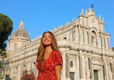 Smiling female tourist visiting Catania Cathedral in Sicily. Summer holidays in Italy royalty free stock photo
