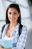 Smiling female university student Stock Images