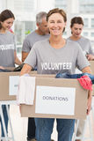 Smiling female volunteer carrying donation box Stock Photography