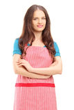 Smiling female wearing an apron and looking at camera Royalty Free Stock Photography
