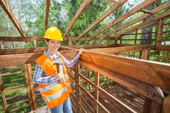 Smiling Female Worker Holding Hammer In Timber Royalty Free Stock Photo