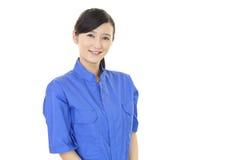 Smiling female worker. Isolated on white background Stock Photos