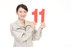 Smiling female worker with a number Royalty Free Stock Photo