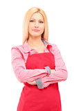 Smiling female worker wearing an apron and looking at camera Stock Photography