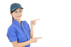 Smiling female worker. The female worker who poses happy on white background Stock Image