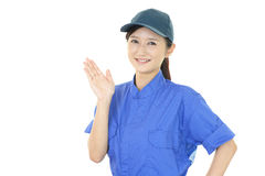 Smiling female worker Stock Image