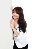 Smiling female young doctor holding blank white board Stock Photos