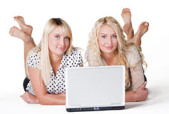 Smiling females with laptop Stock Photography