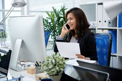 Pretty Filipina woman at work royalty free stock image