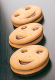 Smiling filled chocolate biscuits Stock Photography