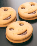 Smiling filled chocolate biscuits Stock Images