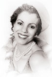 Smiling filmstar. Vintage 1920s woman wearing a pink pillbox hat royalty free stock images