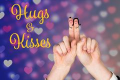 Smiling finger couple with hugs and kisses message. Against digitally generated hearts background Royalty Free Stock Photo