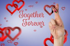 Smiling finger couple in love with red hearts Stock Photo
