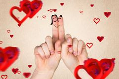 Smiling finger couple in love with red hearts Royalty Free Stock Images