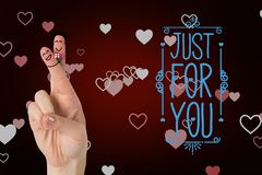 Smiling finger couple with valentines message against red background. Digital composition of smiling finger couple with valentines message against red background Royalty Free Stock Image