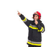 Smiling firefighter directing Royalty Free Stock Photos