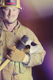 Smiling Firefighter Holding Axe Stock Photos