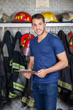 Smiling Firefighter Holding Clipboard At Fire Stock Images
