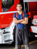 Smiling Firefighter Standing Arms Crossed Stock Image