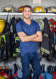 Smiling Firefighter Standing At Fire Station Stock Photo