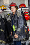 Smiling Firefighter In Uniform At Fire Station Stock Image