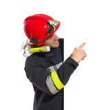 Smiling fireman in red helmet pointing at the blank banner Stock Images